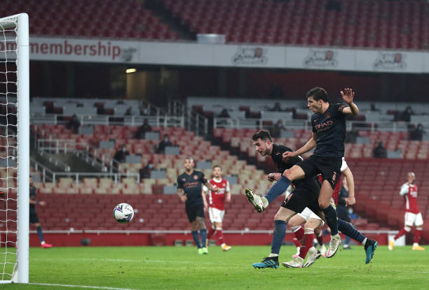 Aymeric Laporte of Manchester City scores their team's fourth goal during the Carabao Cup Quarter Final match between Arsenal and Manchester City at...