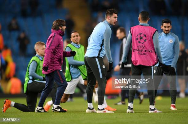 Aymeric Laporte of Manchester City warms up ahead of the UEFA Champions League Round of 16 Second Leg match between Manchester City and FC Basel at...