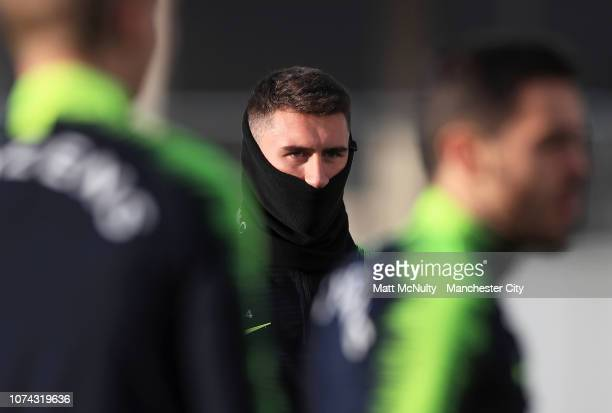 Aymeric Laporte of Manchester City wears a snood during the training session at Manchester City Football Academy on December 17 2018 in Manchester...