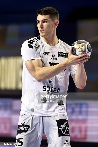 Aymeric Minne of HBC Nantes passes the ball during the VELUX EHF Champions League FINAL4 semi-final between FC Barcelona v HBC Nantes at Lanxess...