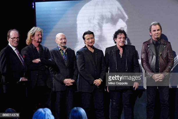 Aynsley Dunbar Gregg Rolie Steve Smith Steve Perry Neal Schon and Jonathan Cain of Journey accept an award onstage at the 32nd Annual Rock Roll Hall...
