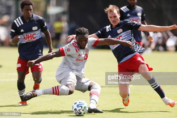 Ayo Akinola of Toronto FC takes a shot on goal against the New England Revolution during a Group C match as part of the MLS Is Back Tournament at...