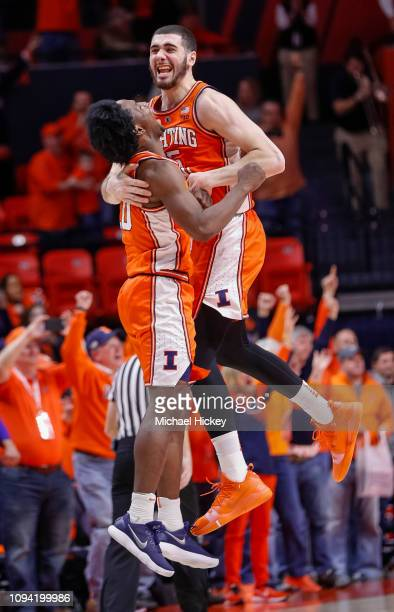 Ayo Dosunmu and Giorgi Bezhanishvili of the Illinois Fighting Illini celebrate after defeating the Michigan State Spartan at State Farm Center on...