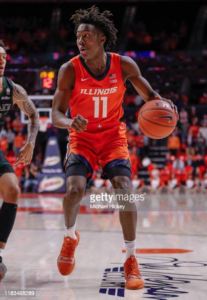Ayo Dosunmu of the Illinois Fighting Illini brings the ball up court during the game against the Hawaii Warriors at State Farm Center on November 18...