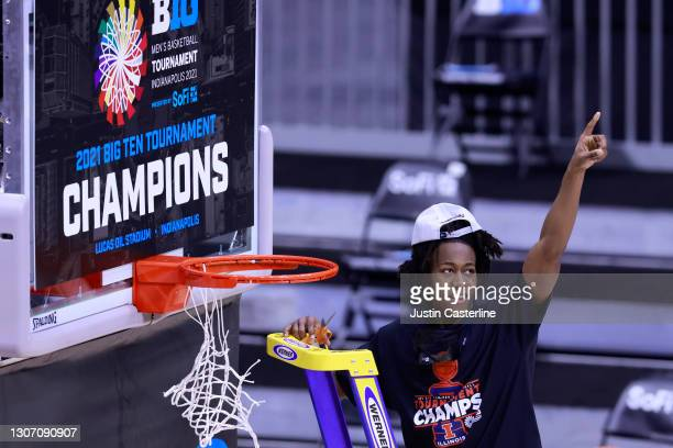 Ayo Dosunmu of the Illinois Fighting Illini cuts down the net to celebrate winning the Big Ten Basketball Tournament championship at Lucas Oil...