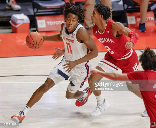Ayo Dosunmu of the Illinois Fighting Illini drives to the basket around Armaan Franklin of the Indiana Hoosiers during the second half at State Farm...