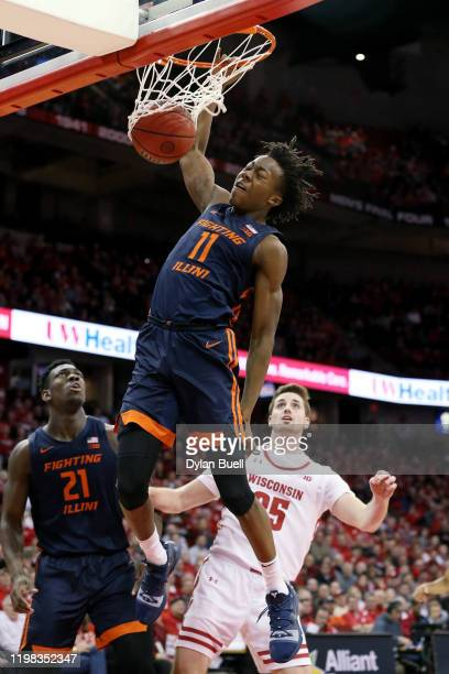 Ayo Dosunmu of the Illinois Fighting Illini dunks the ball in the first half against the Wisconsin Badgers at the Kohl Center on January 08, 2020 in...
