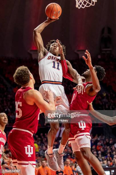 Ayo Dosunmu of the Illinois Fighting Illini shoots the ball against Al Durham of the Indiana Hoosiers during the second half at State Farm Center on...