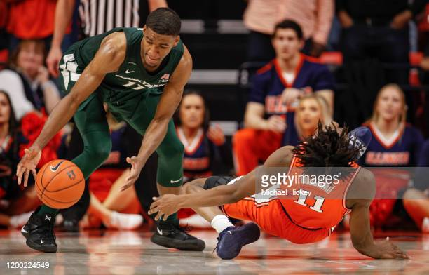 Ayo Dosunmu of the Illinois Fighting Illini slips and is injured on the final play of the game sealing the win for the Michigan State Spartans as...