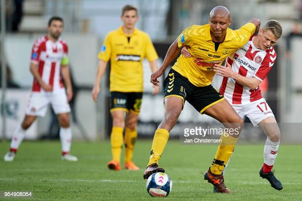 Ayo Simon Okosun of AC Horsens and Kasper Kusk of AaB Aalborg compete for the ball during the Danish Alka Superliga match between AC Horsens and AaB...