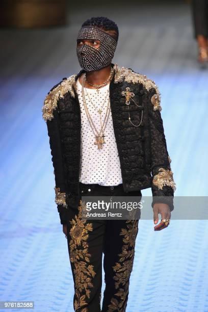 Ayodeji Ibrahim Balogun well knonw as Wizkid walks the runway at the Dolce Gabbana show during Milan Men's Fashion Week Spring/Summer 2019 on June 16...