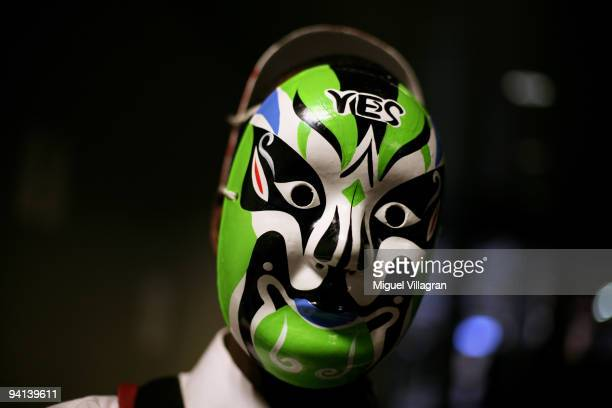 Ayodele Akinpelu wears a green mask with the writing 'yes' during the second day of the United Nations Climate Change Conference 2009 on December 8...