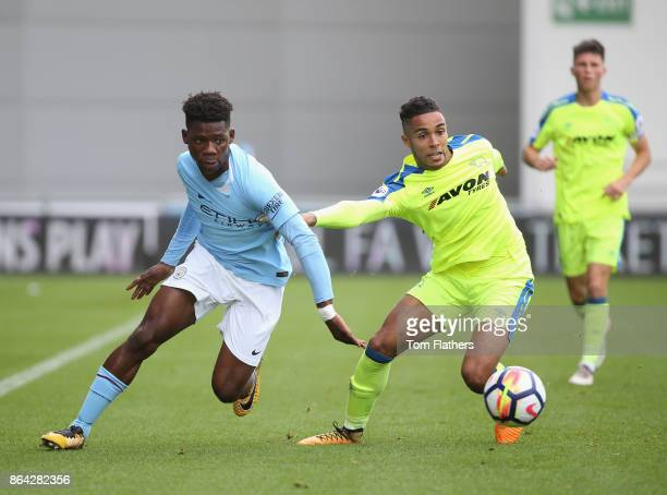 Ayotomiwa DeleBashiru of Manchester City evades a challenge during the Premier League 2 match between Manchester City and Derby County at Manchester...