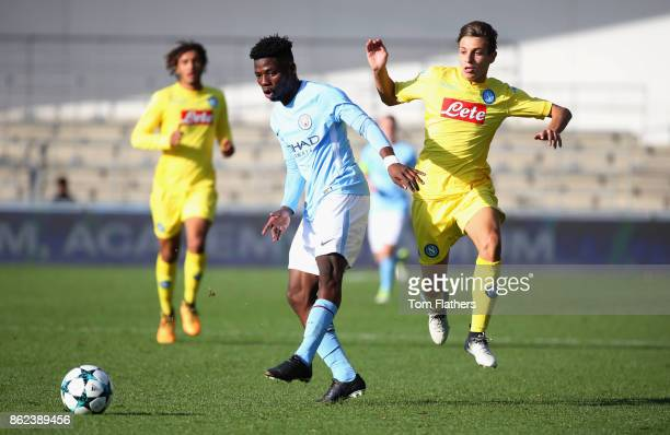 Ayotomiwa DeleBashiru of Manchester City holds off a challenge during the UEFA Youth League Group F match between Manchester City and SSC Napoli at...