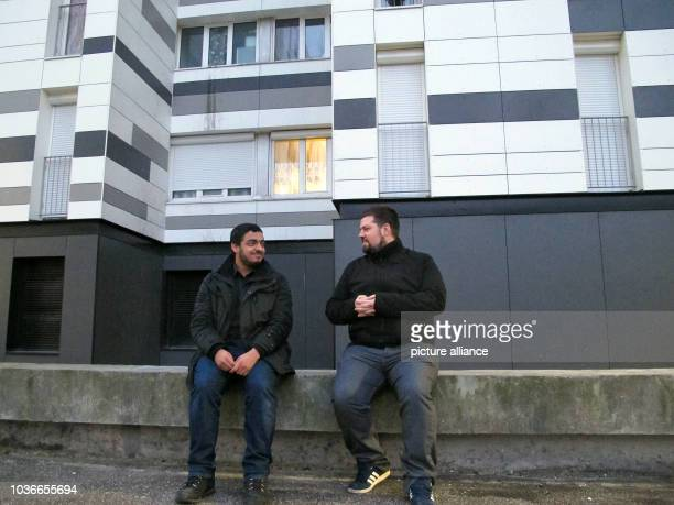 Ayoub Salem member of the independent youth organisations 'Jeunesse ambitieuse' and 'ApoG' and JeanPierre Le Coq sit in front of a house in Bobigny...
