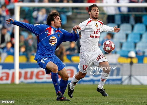 Ayoze Diaz of Mallorca duels for the ball with Pedro Leon of Getafe during the La Liga match between Getafe and Mallorca at Coliseum Alfonso Perez on...