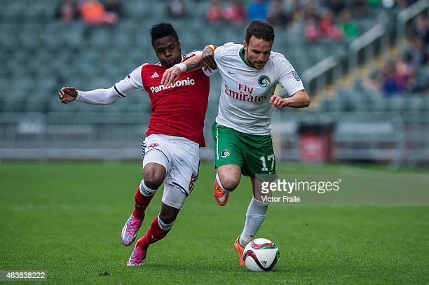 Ayoze Garcia Perez of New York Cosmos and Awal Mahama of South China in action during the 2015 Lunar New Year Cup match between South China and the...