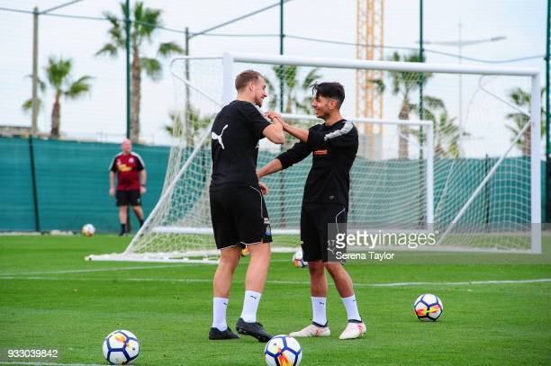 Ayoze Perez and Florian Lejeune joke during the Newcastle United Training Session at Hotel La Finca on March 17 i n Alicante Spain