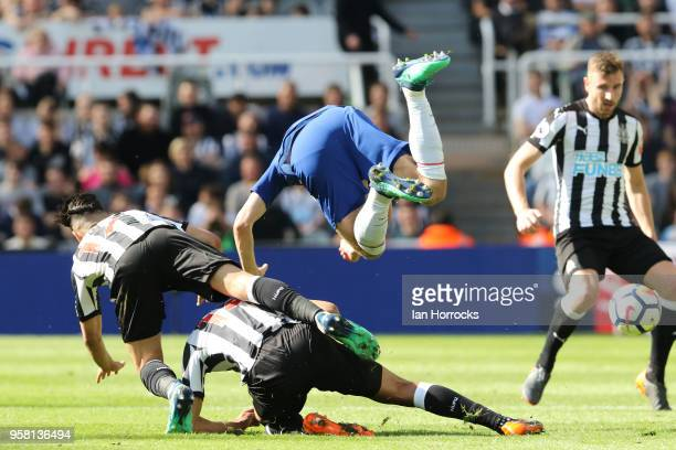Ayoze Perez and Issac Hayden combine to tackle Andreas Christensen of Chelsea during the Premier League match between Newcastle United and Chelsea at...