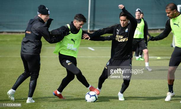 Ayoze Perez controls the ball whilst being challenged by Matt Ritchie and Yoshinori Muto during the Newcastle United Training Session at Newcastle...