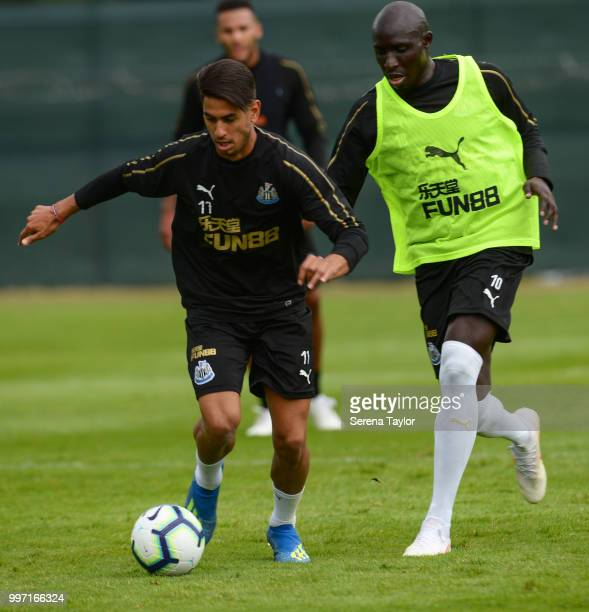Ayoze Perez controls the ball whilst being challenged by Mohamed Diame during the Newcastle United Training session at Carton House on July 12 in...