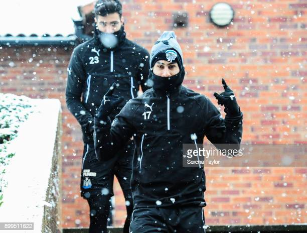 Ayoze Perez holds his hands in the air as he walks down the stairs during the Newcastle United Training session at the Newcastle United Training...