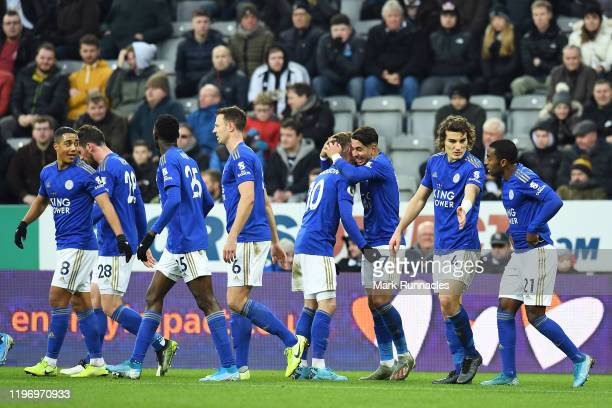 Ayoze Perez of Leicester City celebrates with his team after he scores his sides first goal during the Premier League match between Newcastle United...