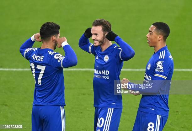 Ayoze Perez of Leicester City celebrates with team mates James Maddison and Youri Tielemans after scoring their sides first goal during the Premier...
