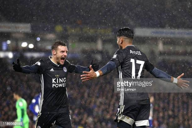 Ayoze Perez of Leicester City celebrates with teammate Jamie Vardy after scoring his team's first goal during the Premier League match between...
