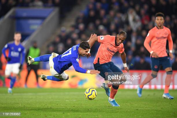 Ayoze Perez of Leicester City is tackled by Djibril Sidibe of Everton during the Premier League match between Leicester City and Everton FC at The...
