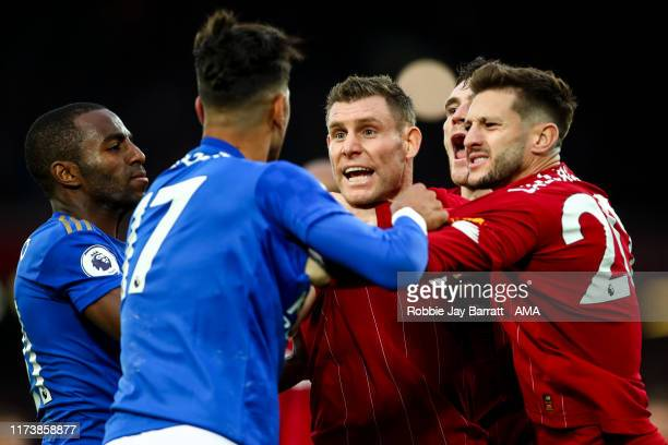 Ayoze Perez of Leicester City react towards James Milner of Liverpool at full time during the Premier League match between Liverpool FC and Leicester...