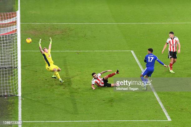 Ayoze Perez of Leicester City scores their sides first goal past Aaron Ramsdale of Sheffield United during the Premier League match between Sheffield...