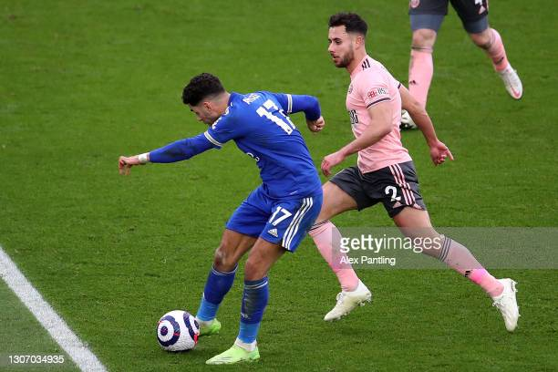 Ayoze Perez of Leicester City scores their side's second goal whilst under pressure from George Baldock of Sheffield United during the Premier League...