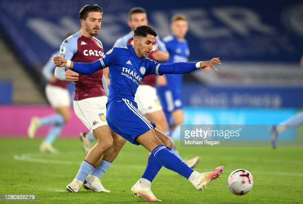 Ayoze Perez of Leicester City shoots under pressure from Jack Grealish of Aston Villa during the Premier League match between Leicester City and...