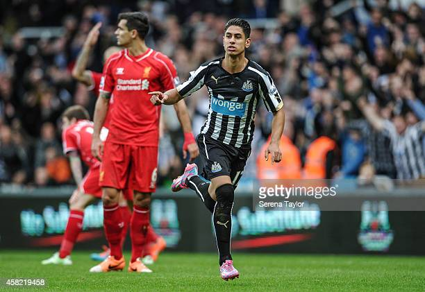 Ayoze Perez of Newcastle celebrates after scoring the opening goal during the Barclays Premier League match between Newcastle United and Liverpool at...