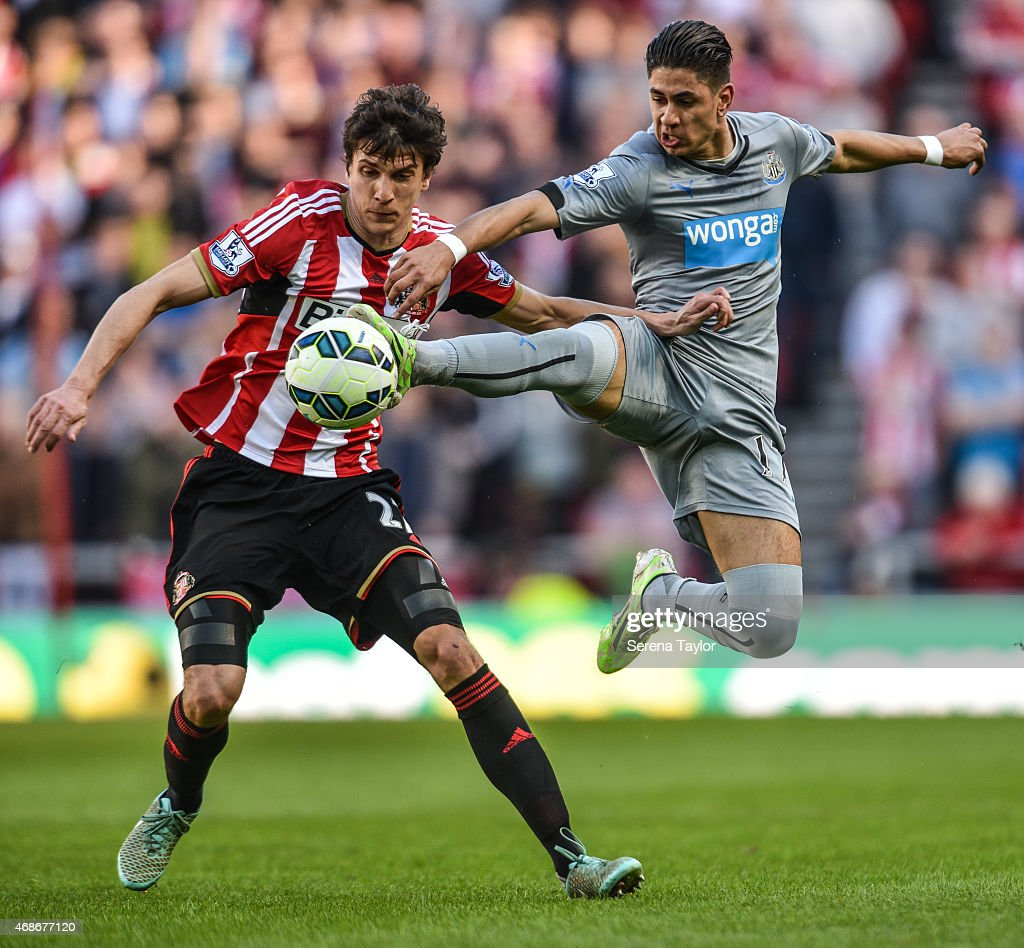 Ayoze Perez (R) of Newcastle intercepts the ball from Santiago Vergini (L) during the Barclays Premier League match between Sunderland FC and Newcastle United at The Stadium of Light on April 5, 2015, in Sunderland, England.
