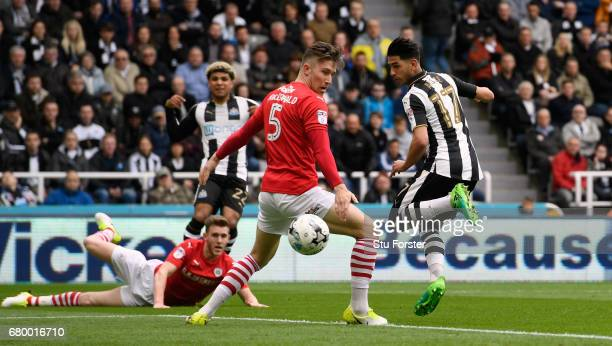 Ayoze Perez of Newcastle scores the opening goal during the Sky Bet Championship match between Newcastle United and Barnsley at St James' Park on May...