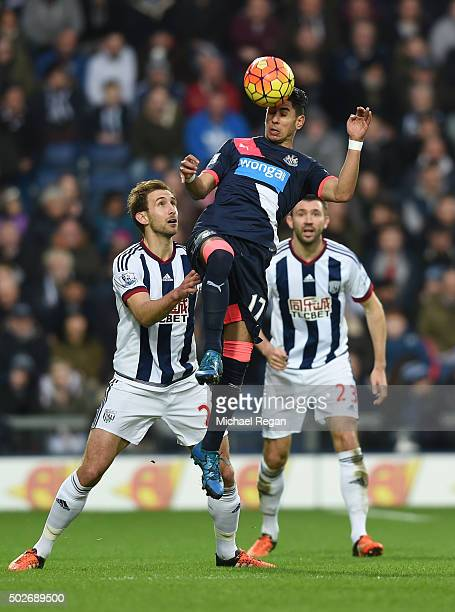 Ayoze Perez of Newcastle United and Craig Dawson of West Bromwich Albion compete for the ball during the Barclays Premier League match between West...