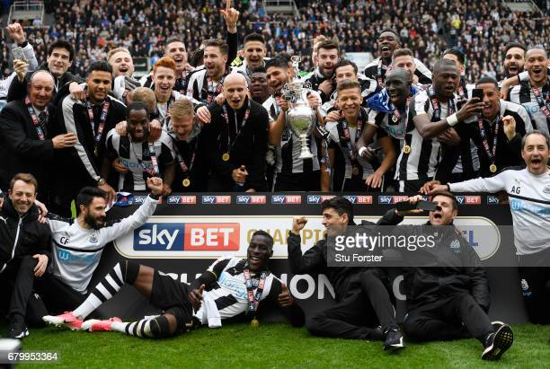 Ayoze Perez of Newcastle United and his Newcastle United team mates celebrate with the Championship Trophy after the Sky Bet Championship match...
