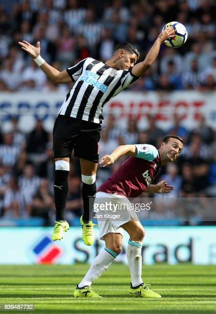 Ayoze Perez of Newcastle United and Mark Noble of West Ham United battle for possession in the air during the Premier League match between Newcastle...