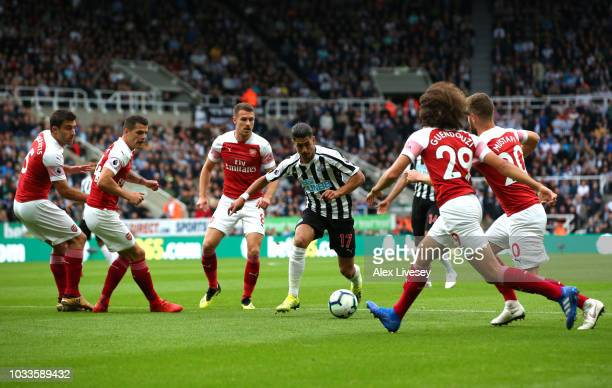 Ayoze Perez of Newcastle United attempts to get past the Arsenal defence during the Premier League match between Newcastle United and Arsenal FC at...