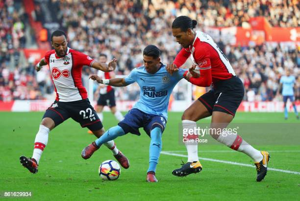 Ayoze Perez of Newcastle United battles with Nathan Redmond and Virgil van Dijk of Southampton during the Premier League match between Southampton...
