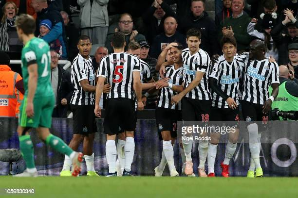 Ayoze Perez of Newcastle United celebrates after scoring his team's first goal with his team mates during the Premier League match between Newcastle...
