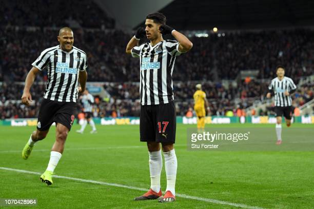 Ayoze Perez of Newcastle United celebrates after scoring his team's first goal with Salomon Rondon during the Premier League match between Newcastle...
