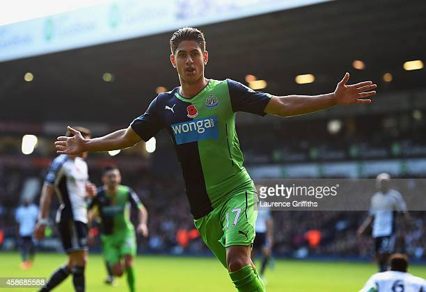 Ayoze Perez of Newcastle United celebrates as he scores their first goal during the Barclays Premier League match between West Bromwich Albion and...