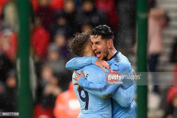 Ayoze Perez of Newcastle United celebrates scoring his sides first goal with team mate Dwight Gayle of Newcastle United during the Premier League...