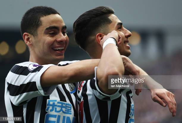 Ayoze Perez of Newcastle United celebrates with Miguel Almiron after he scores his team's second goal during the Premier League match between...