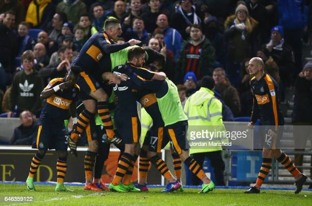 Ayoze Perez of Newcastle United celebrates with team mates as he scores their second goal during the Sky Bet Championship match between Brighton Hove...