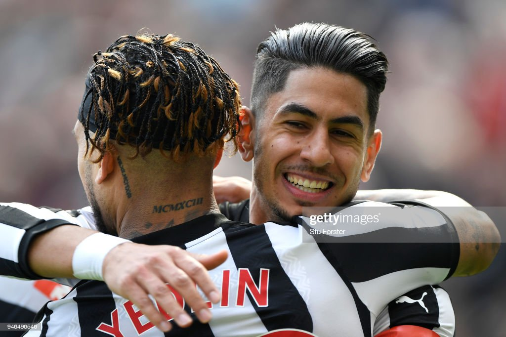 Ayoze Perez of Newcastle United celebrates with teammate Deandre Yedlin after scoring his sides first goal during the Premier League match between Newcastle United and Arsenal at St. James Park on April 15, 2018 in Newcastle upon Tyne, England.