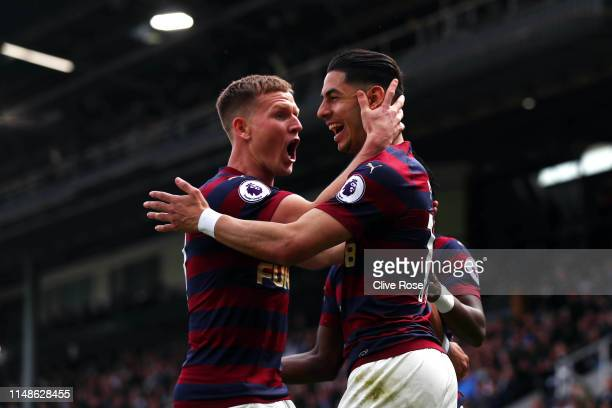 Ayoze Perez of Newcastle United celebrates with teammate Matt Ritchie after scoring his team's second goal during the Premier League match between...